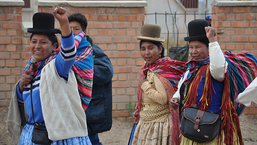If you traveled to Bolivia, you could find out about their customs, including their brightly colored blankets and their hats.