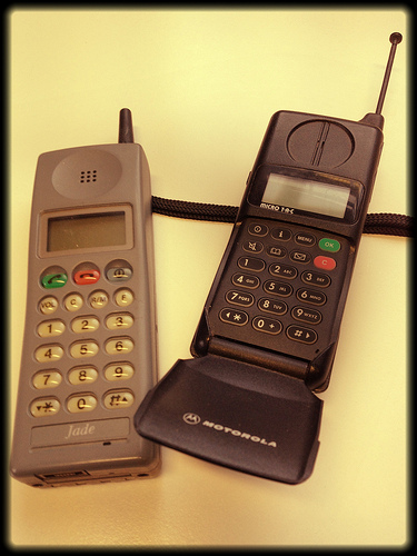These are old phones. But they still make calls. It might be pushing the point a little, but can you survive with just a phone? Or do you crave the latest phone?